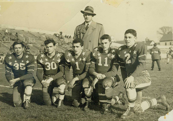In this photo from the Manning Bowl in Lynn on Dec. 5, 1948, Beverly High head coach Charlie Walsh poses with his all-stars from Beverly High, from left: Paul Fraser, Ray LeClerc, Mickey Abate, Billy Ransom and Sandy Kessaris. Then known as the Golden Warriors, Beverly posted the first unbeaten and untied season in school history in 1948, going 9-0-0.