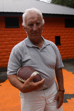 Beverly: Former Beverly High School Football coach, Bill Hamor, poses with a football at Hurd Stadium in Beverly.