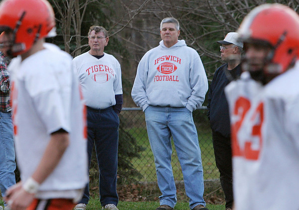 Ipswich: Jack Welch, of Newburyport, stands on the sidelines of the Ipswich football practice(2006)  with Bubba Galanis and David Drown, both of Ipswich, on Thursday afternoon.  Both Galanis and Drown played football for Welch when he was the coach at Ipswich High in the 1960s.