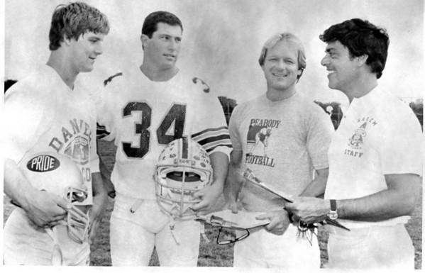 From left, Duke St. Pierre, Ed Sapienza, Ed Nizwantowski and Ken Perrone chat before an Agganis football game.