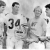 From left, Duke St. Pierre, Ed Sapienza, Ed Nizwantowski and Ken Perrone chat before an Agganis football game.