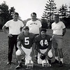 Swampscott preseason camp at St. Anselm: quarterback Mike Lynch, left, and fullback/captain James Carone with coaches Frank DeFelice, left, Bondelevitch and Dick Lynch