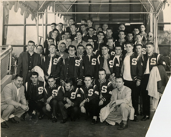 Bob Bondelevitch, left, with unbeaten 1957 Swampscott team that was rewarded with a trip to the college Orange Bowl in Miami. Assistant coach Dick Lynch, kneeling on right.