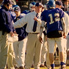 Danvers: Prep head coach talks strategy with quarterback John Mccarthy in the third quarter against Xaverian High School Thursday morning in Danvers.  (Photo by Jim Daly/Salem News). Thursday, November 27, 2003