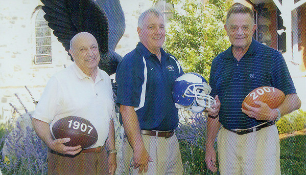 From left, Buster DiVincenzo, former St. John's Prep athletic director and football coach, current head coach and athletic director Jim O'Leary and ex-head coach Fred Glatz represent a lot of football history for the Eagles. On this particular occasion the three were commemorating 100 years of Prep football.
