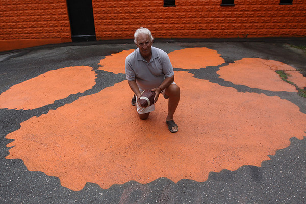 Beverly: Former Beverly High School Football coach, Bill Hamor, poses at Hurd Stadium in Beverly.