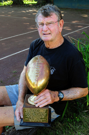 Newburyport: Jack Welch with the trophy that commemorated his 100th win in 1979. Bryan Eaton/Staff Photo