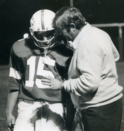 Arthur Adamopoulos, shown here speaking with quarterback Tom Trogler, was a master at getting the most out of his players and getting them to believe they could beat any opponent at any time with a strong running game and a staunch defense.