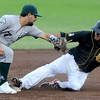 Blasters speedster Maikol Gonzalez slides under the tag of Gary Southshore's xx xx (7) during their game on Tuesday night at Joe Becker Stadium.<br /> Globe | Laurie Sisk