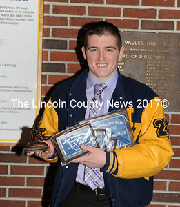 Medomak Valley senior wrestler Cyril MIller collected a armload of plaques and trophies at Winter Sports night on March 3.