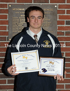 Medomak Valley swimmer Gavin Felch was presented a three letter plaque and a seven letter jacket.