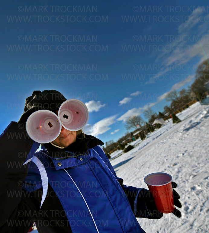 Becky Krueger, of the Red Solo Cup Team, looks through her beer goggles during the Orono Lions 25th annual 'Snowball Open' at Nelson Park held Saturday, Jan. 28, on Long Lake.