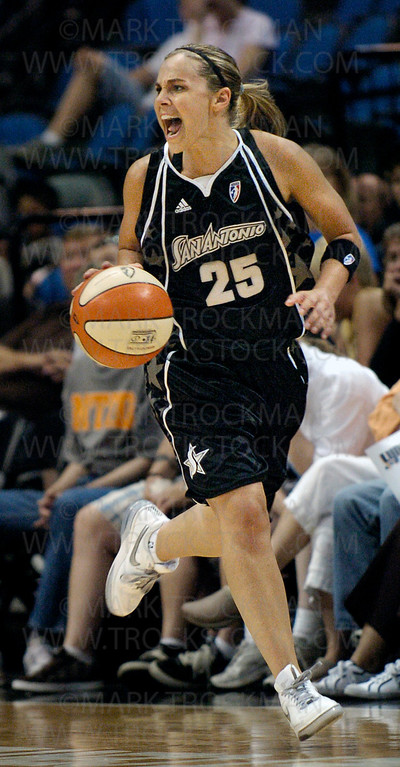 Silver Stars starting guard Becky Hammon moves the ball up-court in the second half of San Antonio's game against the Minnesota Lynx Friday, July 25, 2008 in Minneapolis.