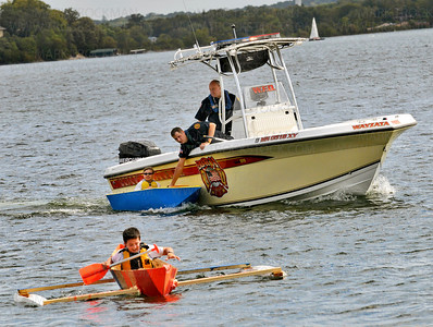 Cecil Dart Invitational boat captains and best friends, Walker Mullin, 11, front, with outriggers, and Wiley Hunt, 11, being held against the Wayzata Fire Dept. boat, bring their handmade crafts toward the finish line of the Wayzata Rotary Club-sponsored build-your-own-boat contest and race at the city docks in front of Sunsets Restaurant Saturday, Sept. 8, during the city's annual James J. Hill Days celebration.