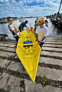 Cecil Dart Invitational boat captain Wiley Hunt, left, gets help from friends bringing his boat out of Wayzata Bay after the Rotary fundraiser Saturday, Sept. 8, during James J. Days in downtown Wayzata.  Wiley, 11, got some help from Wayzata firemen when the wind and the boat's dynamics became too much for Wiley to handle.