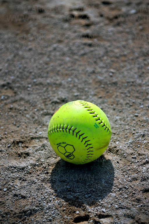 A neon green softball lies in wait before the senior softball game held at Big Willow Park Wednesday morning, May 4, in Minnetonka.