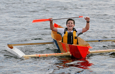 Cecil Dart Invitational boat captain Walker Mullin, 11, celebrates in his outrigger equipped craft as he passes the finish line of the Wayzata Rotary Club-sponsored, build-your-own-boat contest and race at the city docks in front of Sunsets Restaurant Saturday, Sept. 8, during the city's annual James J. Hill Days celebration.