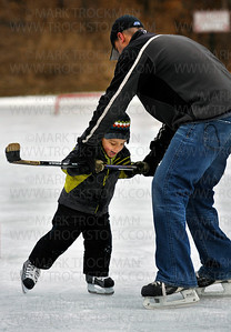 Three year old Kaleb Mhiripiri skates with the help of his dad, Titus at the public skating rink at Klapprich Park in Wayzata, Saturday, Jan. 7, 2012.  This was Kaleb's first time on the ice with a hockey stick.