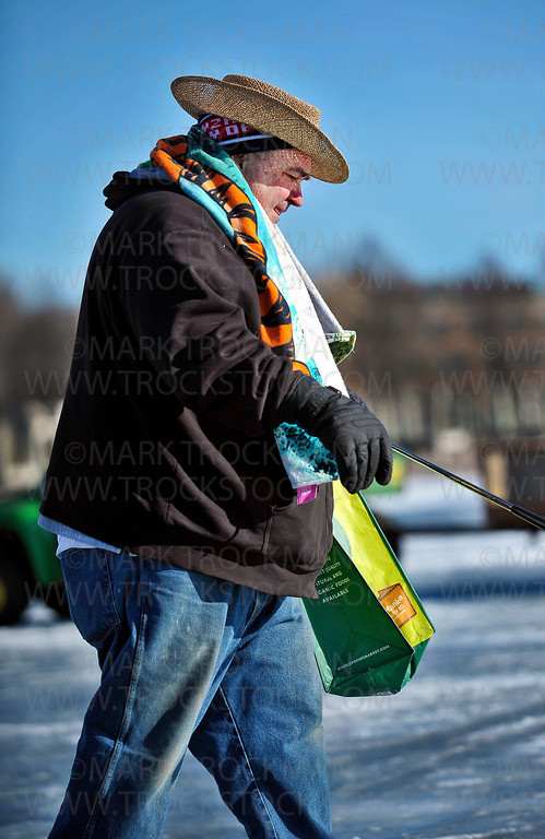 First time participant and Team Hole-in-None member Keith Phillips, St. Paul, strides across frozen Wayzata Bay to tee off at the next hole during the cities' annual Chilly Open on Lake Minnetonka Saturday, Feb. 11, 2012.  This year's Chilly Open bore the theme, 'Beach Party', even though morning temperatures stayed in the single digits.  Saturday was Huerta's first Chilly Open.