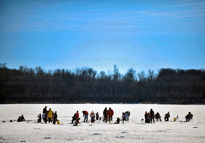 Nearly two dozen people, young and old, attended 'Take a Kid Ice Fishing' on Lake Auburn in the Lowry Nature Center in Carver Park Reserve Saturday, Feb. 18, in Victoria.  Participants learned proper ice fishing techniques and how to make their own jigging pole.