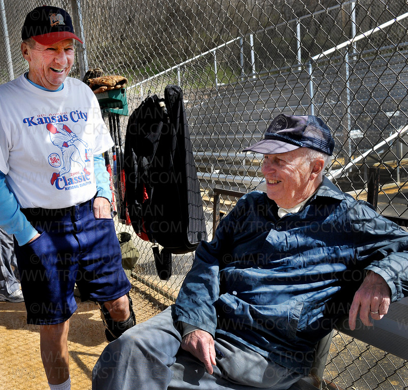 Senior softball players Russ Falness, left, and John Wahl yuck it up in the dugout before their senior softball game Wednesday morning, May 4, at Big Willow Park in Minnetonka.