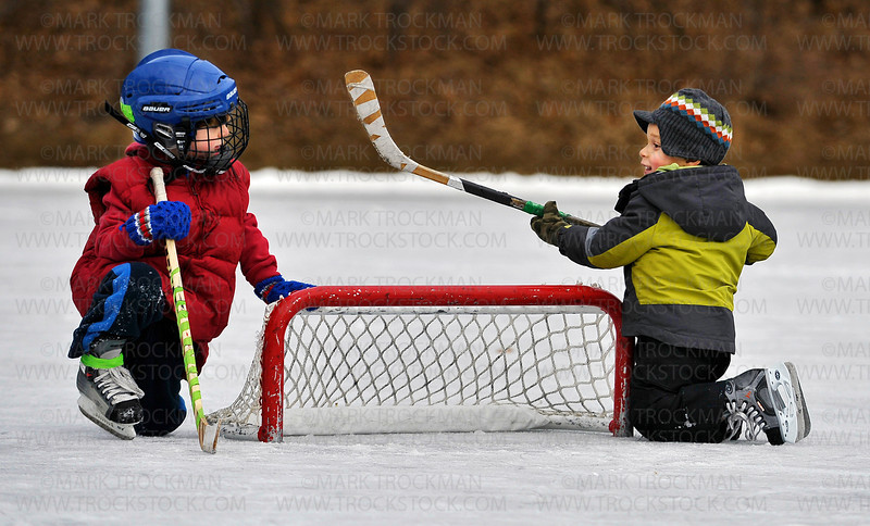 Five year old Bo Delich, left, Victoria, chats with three year old Kaleb Mhiripiri, Plymouth, at a teeny hockey net at the public skating rink at Klapprich Park in Wayzata, Saturday, Jan. 7, 2012.  This was Kaleb's first time on the ice with a hockey stick.