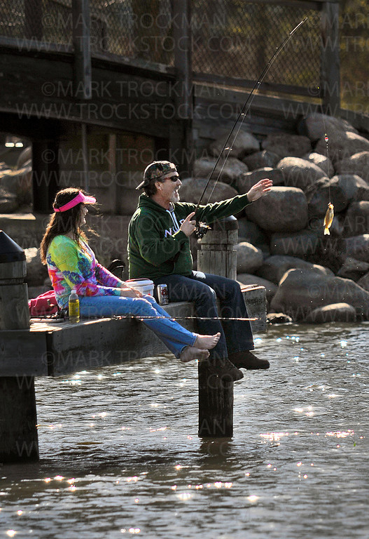 Crappie time.  Jeffrey Barber, right, reels in a Crappie from a pond at Wayzata Beach Sunday, April 1, 2012.  Barber, and his wife Shirlie, St. Louis Park, have been fishing in Lake Minnetonka for decades.  In 1981, Jefferey Barber won the Holiday-Johnson Crappie Contest by pulling in a one-pound, four-ounce specimen, and went home with a 10 HP Johnson boat motor for his efforts.