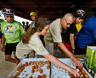 Tour de Tonka riders and volunteers helped themselves to myriad tasty treats and drinks at Excelsior Commons Park Saturday, August 4, on the shore of Lake Minnetonka.  The annual bicycle ride starts at Minnetonka High School and includes non-competitive rides that range in length from 17-miles to 100-miles, with rest stops along the way.