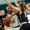 Missouri Southern's Chasidee Owens (22) tries to get past Nebraska-Kearney's Maegan Holt (15) during their game on Thursday night at Leggett & Platt.<br /> Globe | Laurie Sisk