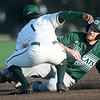 Missouri Southern's Dexter Swims (1) tags out Northwest Missouri's Jay Hrdlicka (8) on an attempted steal at second base during their game on Thursday at Warren Turner Field.<br /> Globe | Laurie Sisk