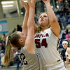 Joplin's Sofie Schuller (54) puts up a shot as Willard's Josie Sanders (32) defends during their game on Wednesday night at Kaminsky Gymnasium.<br /> Globe | Laurie Sisk