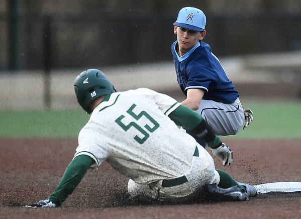 Missouri Southern's Calem Nutting (55) slides into second base for a steal as Washburn's Xavier De Leon applies the late tag during their game on Wednesday afternoon at Warren Turner Field.<br /> Globe | Laurie Sisk