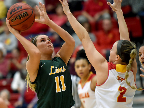 Missouri Southern's Amber Buch  (11) tries to score as Pittsburg State's Kaylee DaMitz (2) defends during their game on Saturday at John Lance Arena.<br /> Globe | Laurie SIsk