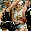 Missouri Southern's Zoe Campbell (10) tries to get past Nebraska-Kearney's Maegan Holt (15) during their game on Thursday night at Leggett & Platt.<br /> Globe | Laurie Sisk