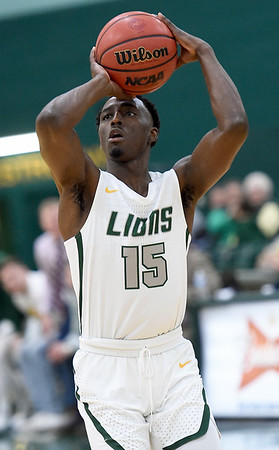 Missouri Southern's Elyjah Clark hits a three-pointer during the Lions game against Nebraska-Kearney on Thursday night at Leggett & Platt.<br /> Globe | Laurie Sisk