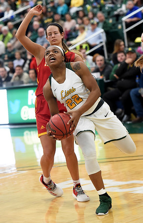 Missouri Southern's Chasidee Owens (22) gets past Pittsburg State's Shelby Lopez during their game on Tuesday night at Leggett & Platt.<br /> Globe | Laurie Sisk