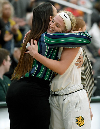 Missouri Southern senior Chelsey Henry gets a hug from assistant coach Chamissa Anderson after Henry played the final home game of her career on Tuesday night at Leggett & Platt.<br /> Globe   Laurie Sisk