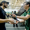 Matt Willis, right, of the Missouri Southern Athletic Department, hands a Jeff Boschee bobblehead to MSSU student Garrett Austin on Tuesday night at Leggett & Platt.<br /> Globe | Laurie SIsk
