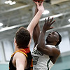 Missouri Southern's Elyjah Clark (15) shoots over Pittsburg State's Jonathan Murray during their game on Tuesday night at Leggett & Platt.<br /> Globe | Laurie Sisk