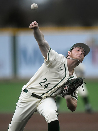 Missouri Southern's Will Bausinger delivers a pitch to the plate during the Lions game against Washburn on Wednesday afternoon at Warren Turner Field.<br /> Globe | Laurie Sisk