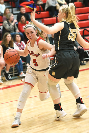 Carl Junction's Danielle Wrensch (5) works to get past Neosho's Brylee King (15) during their semifinal game of the Class 4 District 12 tournament on Wednesday night at Webb City High School.<br /> Globe | Laurie Sisk