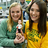 Missouri Southern freshmen Keaton Campbell, left and Delanie Thompson, both of Joplin, display a Jeff Boschee bobblehead on Tuesday night at Leggett & Platt.<br /> Globe | Laurie SIsk