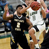 Missouri Southern's Reggie Tharp (0) drives to the basket as Fort Hays State's Nyjee Wright (2) defends during their game on Saturday at Leggett & Platt.<br /> Globe | Laurie Sisk