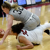 Joplin's Dayleigh Smith , bottom and Willard's Josie Sanders battle for a loose ball during their game on Wednesday night at Kaminsky Gymnasium.<br /> Globe | Laurie Sisk