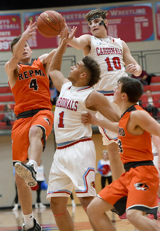 Webb City's Gary Clinton (10) and Terrell Kabala (1) battle Republic's Trent Rackley (4) for a rebound as Jaden Duvall (13) looks on during their game on Friday night at Webb City High School.<br /> Globe | Laurie SIsk