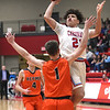 Webb City's Nickhai Howard (21) drives to the basket as Republic's Race Looney (1) defends during their game on Friday night at Webb City High School.<br /> Globe | Laurie SIsk