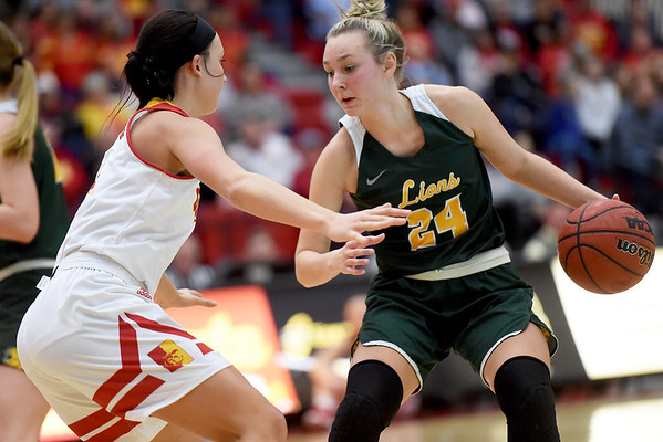 Missouri Southern's Morgan Brightwell (24) tries to get past Pittsburg State's Sydeny Tracy (3) during their game on Saturday at John Lance Arena.<br /> Globe | Laurie SIsk