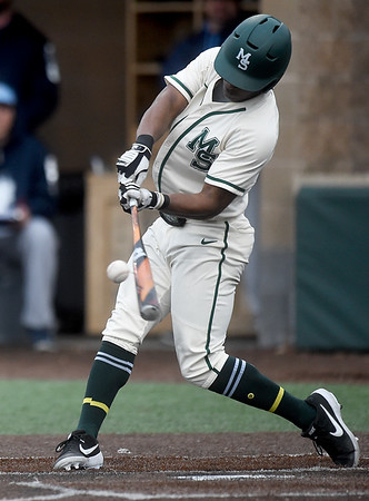 Missouri Southern's Ryan Hunter connects for a solo homerun during the Lions game against Washburn on Wednesday afternoon at Warren Turner Field.<br /> Globe | Laurie Sisk