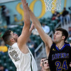 Missouri Southern's Enis Memic (12) shoots over Nebraska-Kearney's Weston Baker Magrath (24) during their game on Thursday night at Leggett & Platt.<br /> Globe | Laurie Sisk