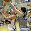 Joplin's Grace Ipsen (10) puts up a shot as Willard's Kaitlyn Burson (40) defends during their game on Wednesday night at Kaminsky Gymnasium.<br /> Globe | Laurie Sisk